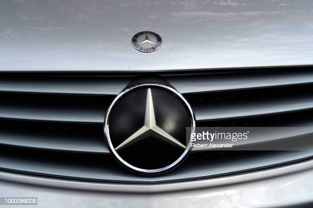 The Mercedes Benz logo on a hood emblem and grille of a vintage Mercedes Benz on display at a classic car show in Santa Fe New Mexico