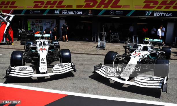The Mercedes GP team show off their car with a new white and silver livery in the Pitlane during previews ahead of the F1 Grand Prix of Germany at...