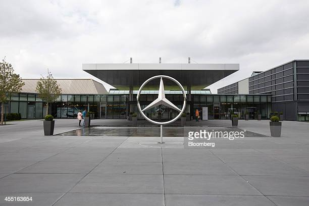 The Mercedes logo a threepointed star in a laurel wreath is seen standing outside the MercedesBenz AG customer center near Stuttgart Germany on...