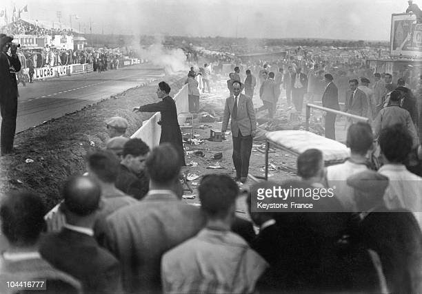 The Mercedes of Pierre Levegh has exploded into the crowd at 300km/h causing 82 deaths and hundreds wounded at the 24h of Le Mans June 11 1955