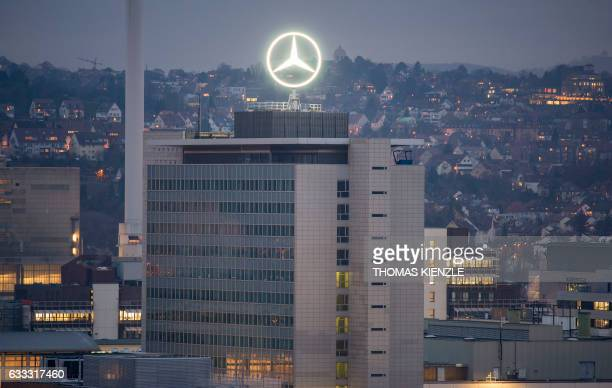 The Mercedes star is illuminated on the headquarters of Daimler AG in Stuttgart southwestern Germany on February 1 the day before German luxury...