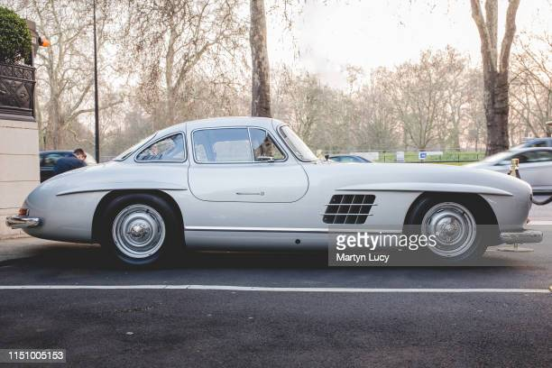 The MercedesBenz 300 SL outside the Dorchester Hotel in London England The 300 SL was produced from 1954 to 1963 First as a coupe from 1954 to 1957...
