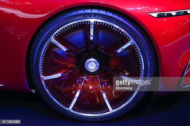 The Mercedes-Benz AG logo sits on the wheel hub of an ultra-luxury Vision Mercedes Maybach 6 automobile, manufactured by Mercedes-Benz AG, during the...