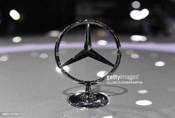 The MercedesBenz logo is seen on a car on display during the 39th Bangkok International Motorshow in Bangkok on March 29 2017 / AFP PHOTO / LILLIAN...