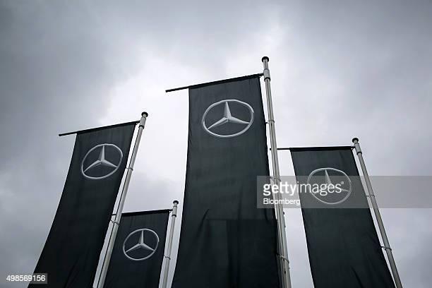 The MercedesBenz logo sits on banners flying outside Daimler AG's MercedesBenz factory in Sindelfingen Germany on Monday Nov 23 2015 Daimler's...
