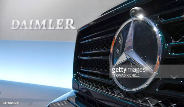 The MercedesBenz star is displayed on the front of a MercedesBenz Gmodel at the annual press conference of German auto giant Daimler AG in Stuttgart...