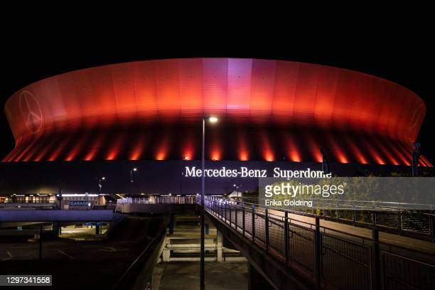 The Mercedes-Benz Superdome illuminates an amber hue light to support the Biden Inaugural Committee's COVID-19 Memorial: A National Moment of Unity...