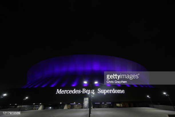 The Mercedes-Benz Superdome is lit up blue on April 09, 2020 in New Orleans, Louisiana. Landmarks and buildings across the nation are displaying blue...
