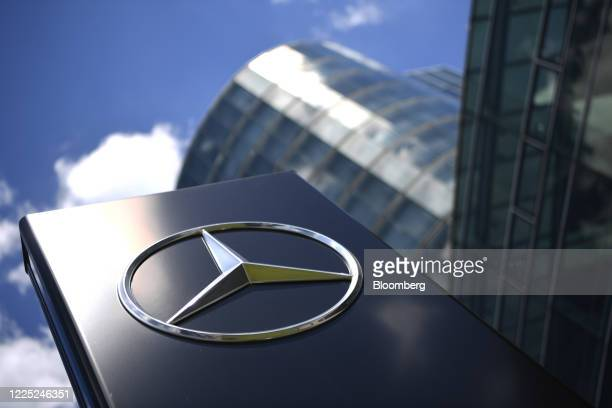 The Mercedes-Benz trident logo sits on display outside the automaker's showroom, operated by Daimler AG, in Munich, Germany, on Tuesday, July 7,...