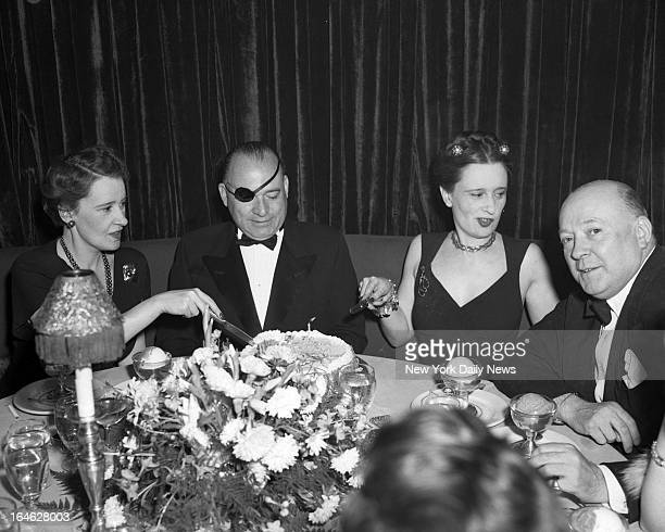 The Mergan twins Lady Thelma Furness and Gloria Vanderbilt cut cake in Champagne Room of El Morocco Night Club They're escorted by Maurice Chalom and...