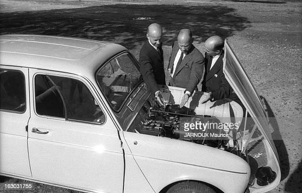 The Merlin Brothers At The Auto Show 1961 Olivier MERLIN et ses frères Didier et Roland examinant le moteur de la Renault 4