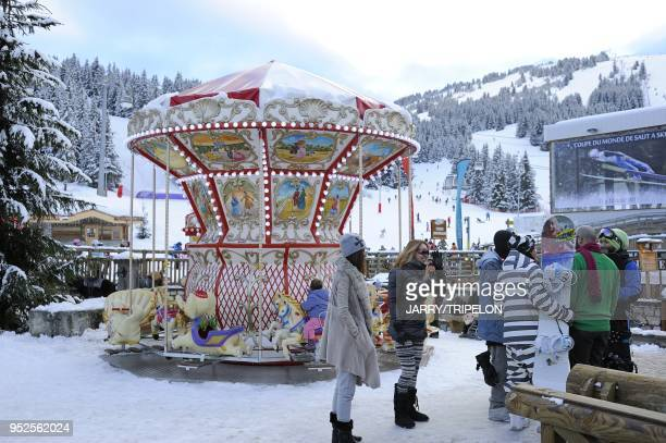 The merry go round in front of the CroisetteCourchevel 1850 ski resort, Trois Vallees skiing area, Tarentaise valley, Savoie department, Rhone Alpes...