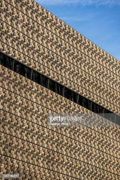 The mesh metal exterior of the National Museum of African American History and Culture is viewed on June 4 2017 in Washington DC The nation's capital...
