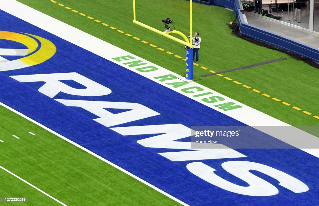 """The message """"End Racism"""" is seen in the end zone during the game between the Dallas Cowboys and the Los Angeles Rams at SoFi Stadium on September 13,..."""
