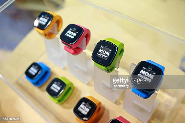 """The message """"Mom Calling"""" sits on a display of FiLIP range smart watches in the Telefonica SA pavilion at the Mobile World Congress in Barcelona,..."""