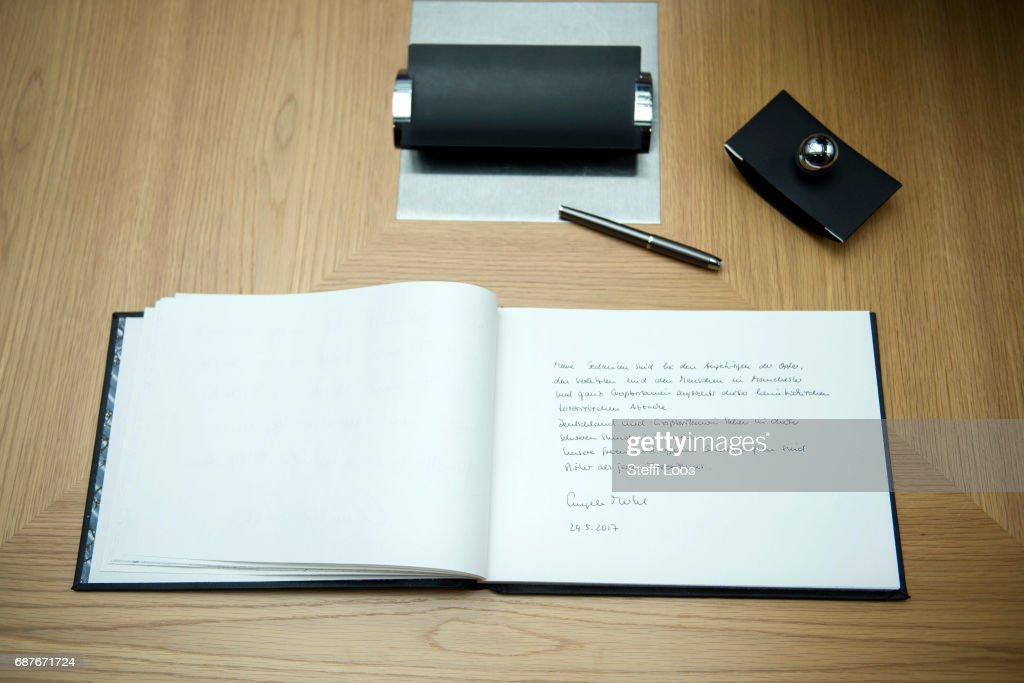 The message of German Chancellor Angela Merkel is displayed in a book of condolence at the British embassy on May 24, 2017 in Berlin, Germany. An explosion occurred at Manchester Arena as concert goers were leaving the venue after Ariana Grande had performed. Greater Manchester Police are treating the explosion as a terrorist attack and have confirmed 22 fatalities and 59 injured.