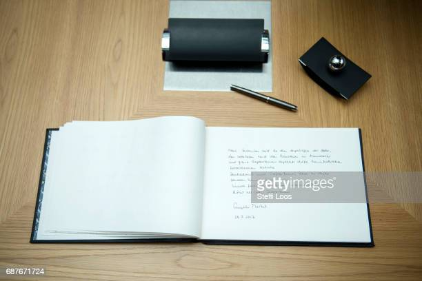 The message of German Chancellor Angela Merkel is displayed in a book of condolence at the British embassy on May 24 2017 in Berlin Germany An...
