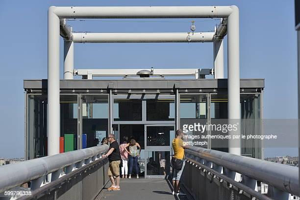 The metallic footbridge to elevator