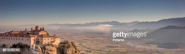 the meteora, view at one of the monasteries in kalambaka, in greece thessaly plain. - thessaly stock pictures, royalty-free photos & images
