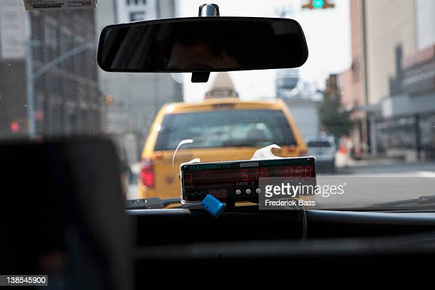the meter in a taxi, seen from the passenger's perspective - fare stock pictures, royalty-free photos & images