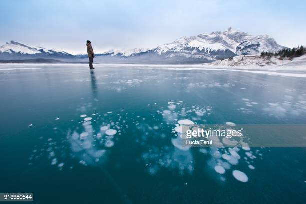 The methane bubbles in the ice over Abraham Lake, Alberta, Canada