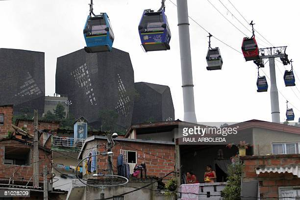 The Metro Cable railway goes past over a popular neighborhood and next to the Spain Library in Medellin on April 28 2008 The Colombian city of...