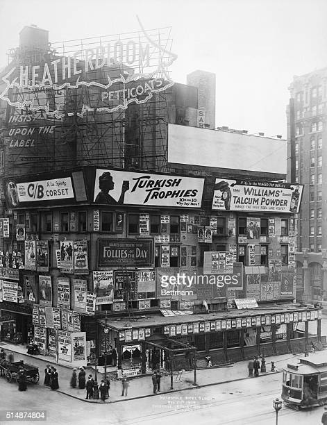 The Metropole Hotel is covered in advertising signboards, 1909.