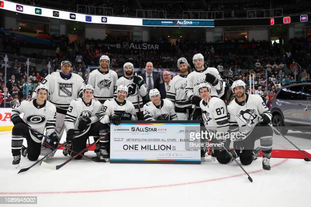 The Metropolitan Division AllStars pose after winning the 2019 Honda NHL AllStar Game at SAP Center on January 26 2019 in San Jose California