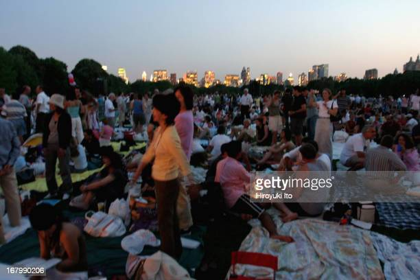 """The Metropolitan Opera performing Puccini's """"Tosca"""" at Great Lawn in Central Park on Tuesday night, June 14, 2005.This image;The audience during the..."""