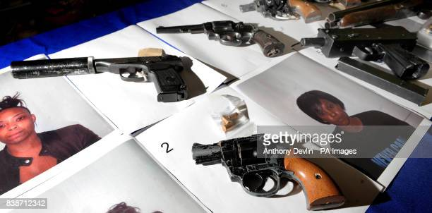 The Metropolitan Police's antishooting unit Trident displays confiscated firearms as it launches its ninth annual advertising campaign