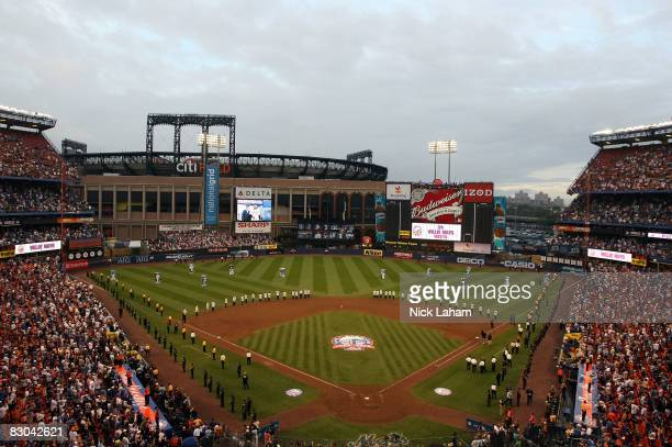 The Mets take part in a post game ceremony after the last regular season baseball game ever played in Shea Stadium against the Florida Marlins on...