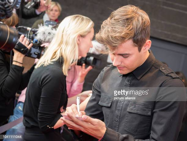 The Mexican actor Jorge Blanco signs autohgraphs at a photocall on the occasion of the the cinema release of 'Tini The Movie' at Cafe Moskau in...