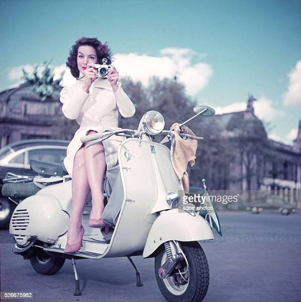 The Mexican actress Maria Felix posing in an advertisement for Vespa scooters in Paris In 1955