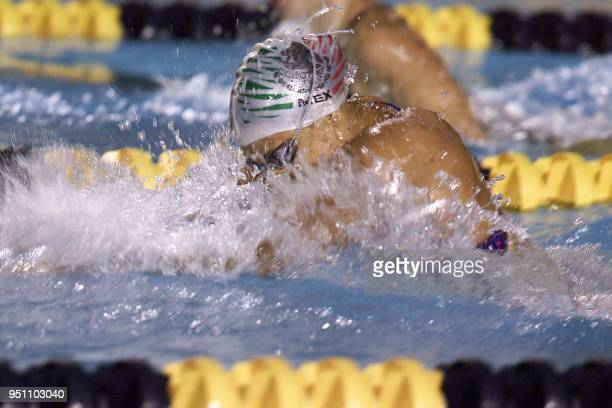 The Mexican Adriana Marmolejo competes 27 November 2002 in the 100 meter breast stroke competition during her participation in the XIX Central...
