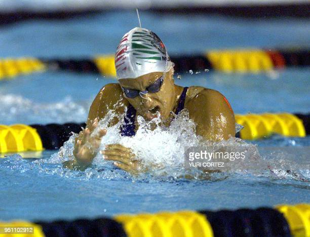 The Mexican Adriana Marmolejo competes 28 November 2002 in the 4x100 meters combined swimming competition of the XIX Central American and Caribbean...