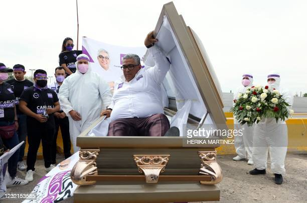 The Mexican candidate for federal deputy of the Social Encounter Party Carlos Mayorga launches his campaign inside a coffin, to highlight the...