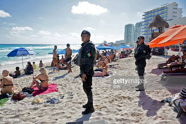 The Mexican federal police patrol a beach in Cancun Mexico on January 18 where a shooting occurred in a nightclub the day before The shooting...