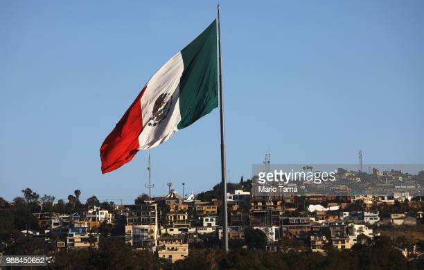 The Mexican flag flies near the USMexico border on June 30 2018 in Tijuana Mexico In the midst of controversial US border policies Mexico's...