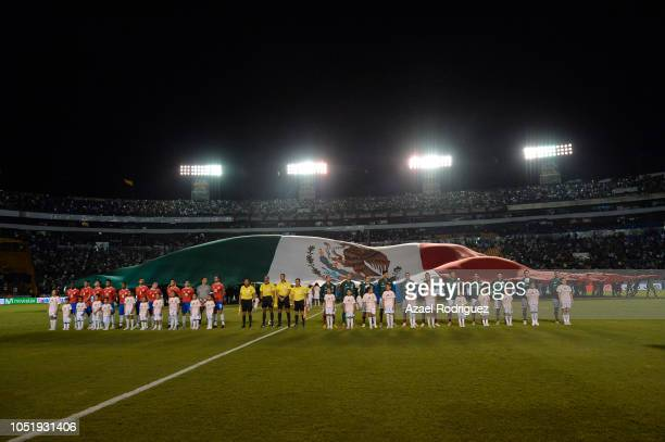 The Mexican flag is seen behind players of Mexico and Costa Rica during the international friendly match between Mexico and Costa Rica at...