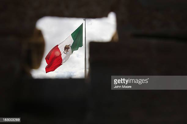 The Mexican flag is seen through the USMexico border fence on October 3 2013 in San Ysidro California While hundreds of thousands of government...