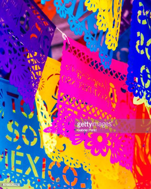 the mexican folk art of papel picado - mexican culture stock photos and pictures