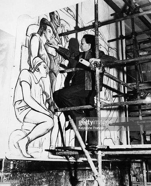 The Mexican painter Diego RIVERA tracing the outline of a 20 by 5 meter fresco which he was to paint in the main hall of New York's Rockefeller...