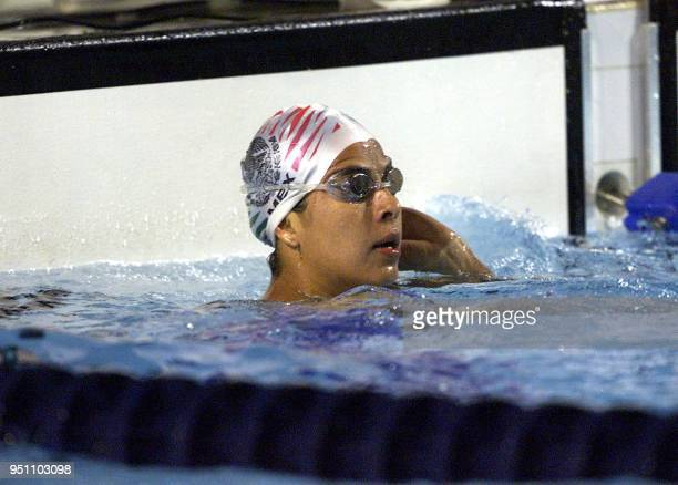 The Mexican Paola Espana observes the stopwatch 27 November 2002 after participating in the 100 meter butterfly swimming competition in the XIX...