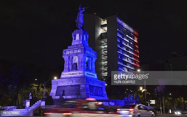 The Mexican Senate building is illuminated with red white and blue colors of the French national flag in solidarity with France after attackers...