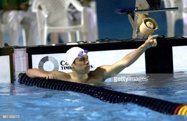 The Mexican swimmer Diego Urreta celebrates 26 November 2002 in San Salvador after winning the gold medal in the 200 meter race during the XIX...