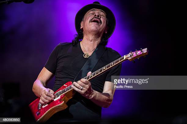 The MexicanAmerican musician Carlos Santana performs on stage during the Moon and Stars Festival 2015 in Locarno