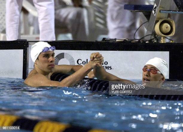 The Mexicans Diego Urreta and Juan Carlos Rodela celebrate after winning silver and gold medals 28 November 2002 in the 100 meter dorso swimming...