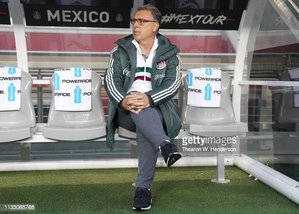 The Mexico National team head coach Gerado Martino sits on the bench and looks on prior to the start of their soccer game against Paraguay during the...