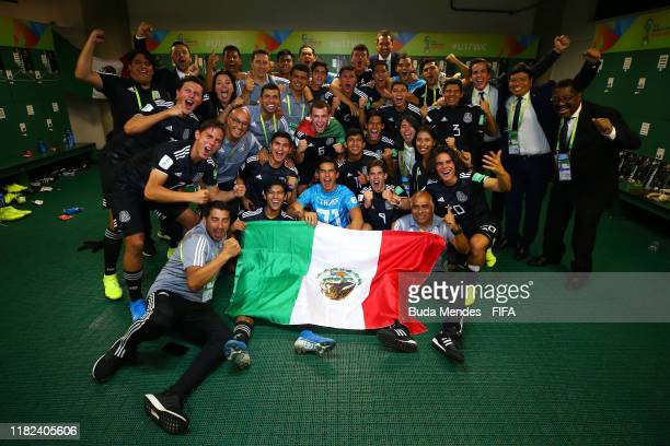 The Mexico players and staff celebrate victory in the dressing room after a penalty shootout during the FIFA U17 World Cup Brazil 2019 semifinal...