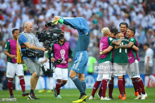 The Mexico players celebrate as Manuel Neuer of Germany removes his shirt at the end of the 2018 FIFA World Cup Russia group F match between Germany...